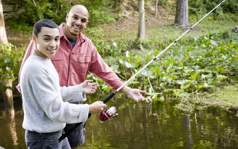 Fishing-wilderness-therapy-with-young-teen-and-older-man